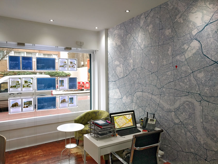 estate agent office with wallpaper map